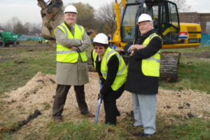 Councillor Susan Quinn cuts the first sod for the Droylsden Marina